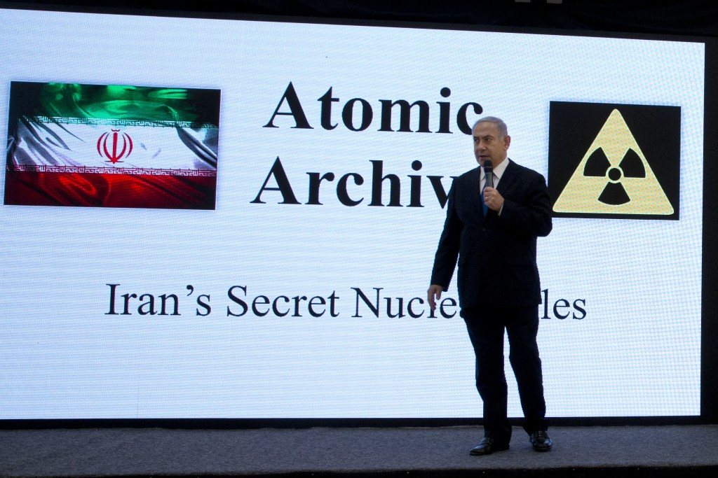 Israeli Prime Minister Benjamin Netanyahu presents material on Iranian nuclear weapons development during a press conference in Tel Aviv, Monday, Apri...