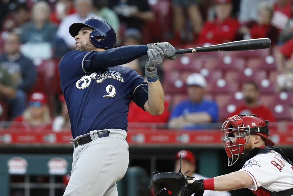 Milwaukee Brewers' Manny Pina hits a solo home run off Cincinnati Reds starting pitcher Brandon Finnegan in the fourth inning of a baseball game, Mond...
