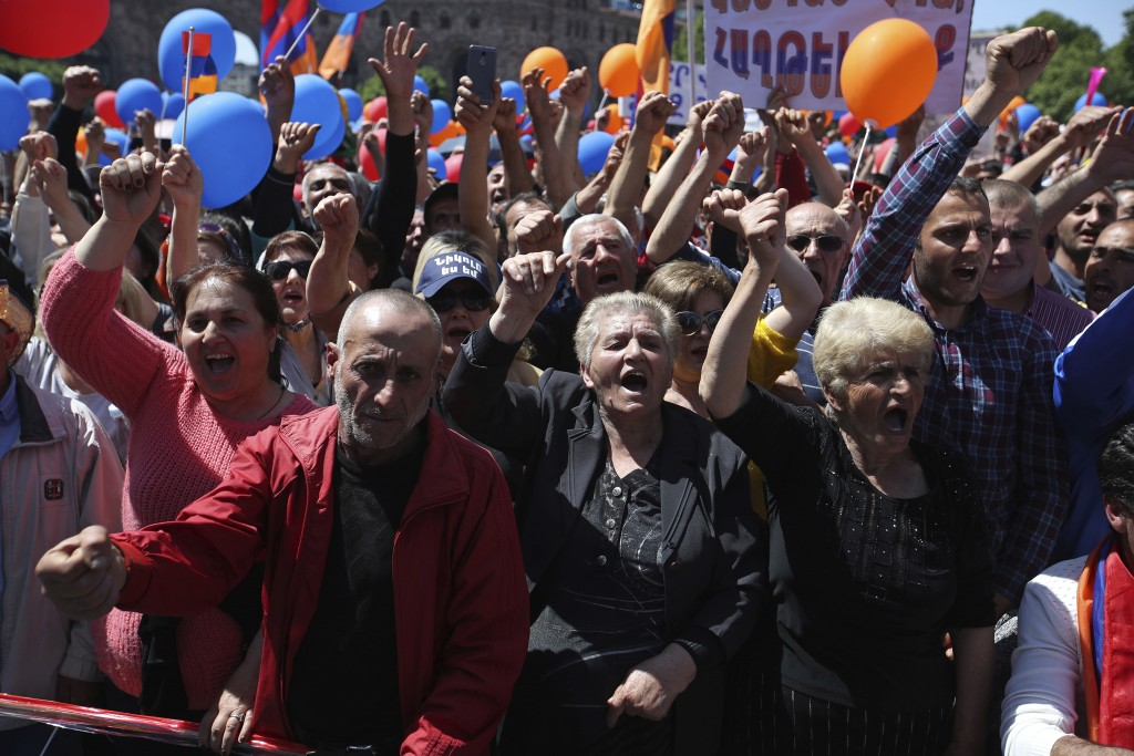 Supporters of the opposition lawmaker Nikol Pashinian shout slogans during a rally at the Republic square in Yerevan on Tuesday, May 1, 2018. Pashinia...