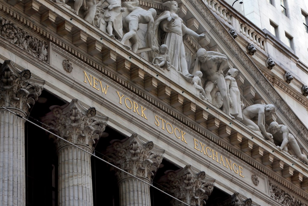 FILE- This April 5, 2018, file photo shows the facade of the New York Stock Exchange. The U.S. stock market opens at 9:30 a.m. EDT on Tuesday, May 1, ...