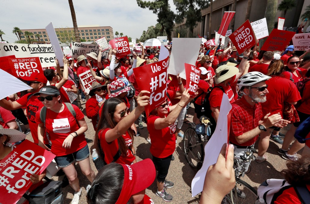 Teachers rally outside of Arizona Gov. Doug Ducey's Executive Tower Monday, April 30, 2018, in Phoenix on their third day of walk outs. Teachers in Ar...