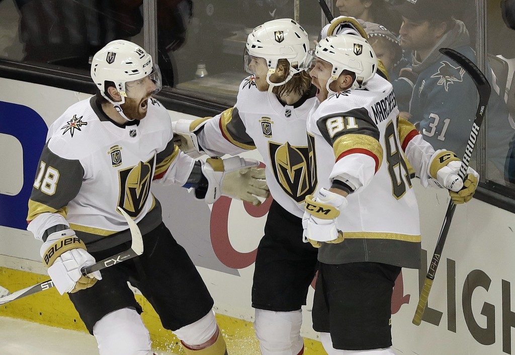 Vegas Golden Knights center William Karlsson, center, from Sweden, celebrates with left wing James Neal (18) and center Jonathan Marchessault (81) aft...
