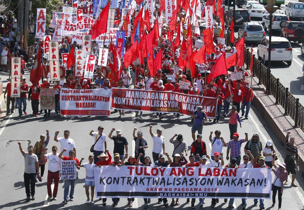 Protesters, mostly workers march towards the Presidential Palace during the global commemoration of Labor Day Tuesday, May 1, 2018 in Manila, Philippi...