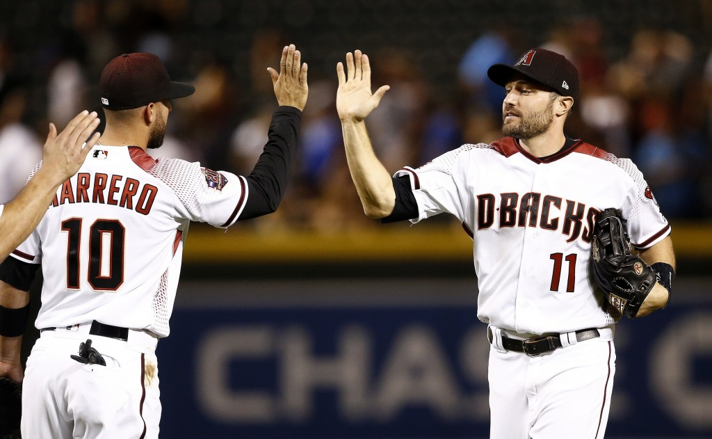 Arizona Diamondbacks' A.J. Pollock (11), who had three home runs on the night, celebrates with Deven Marrero (10) after the final out in the ninth inn...