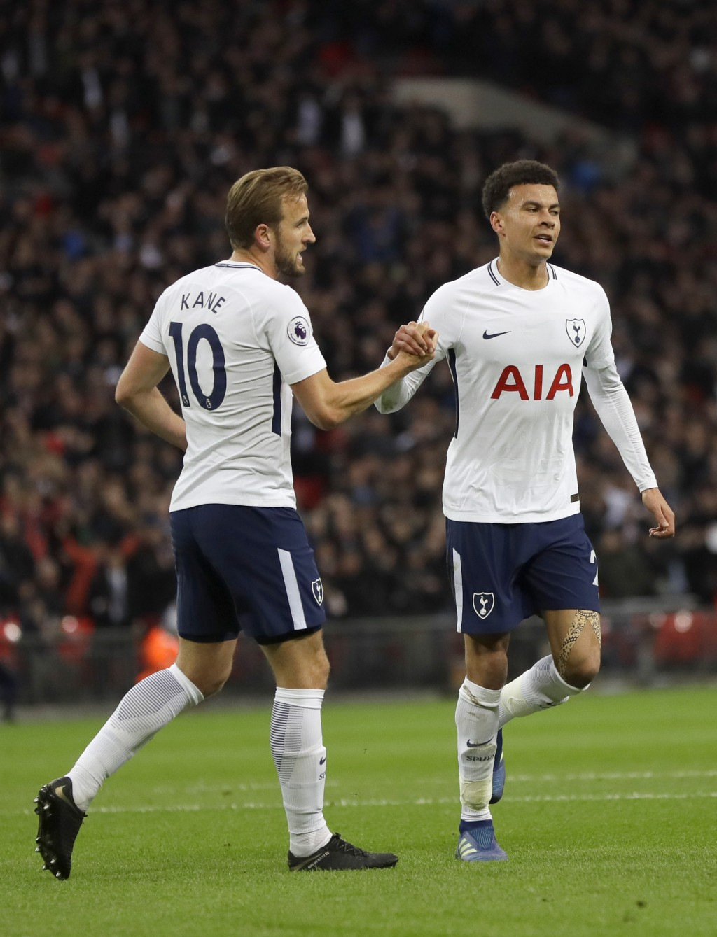 Tottenham's Dele Alli celebrates scoring a goal with Tottenham's Harry Kane during the English Premier League soccer match between Tottenham Hotspur a...