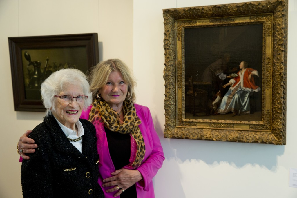 """Ninety-seven-year-old Charlotte Bischoff van Heemskerck, left, and her daughter Rudolphine pose next to the painting """"The Oyster Meal"""" by Jacob Ochter..."""