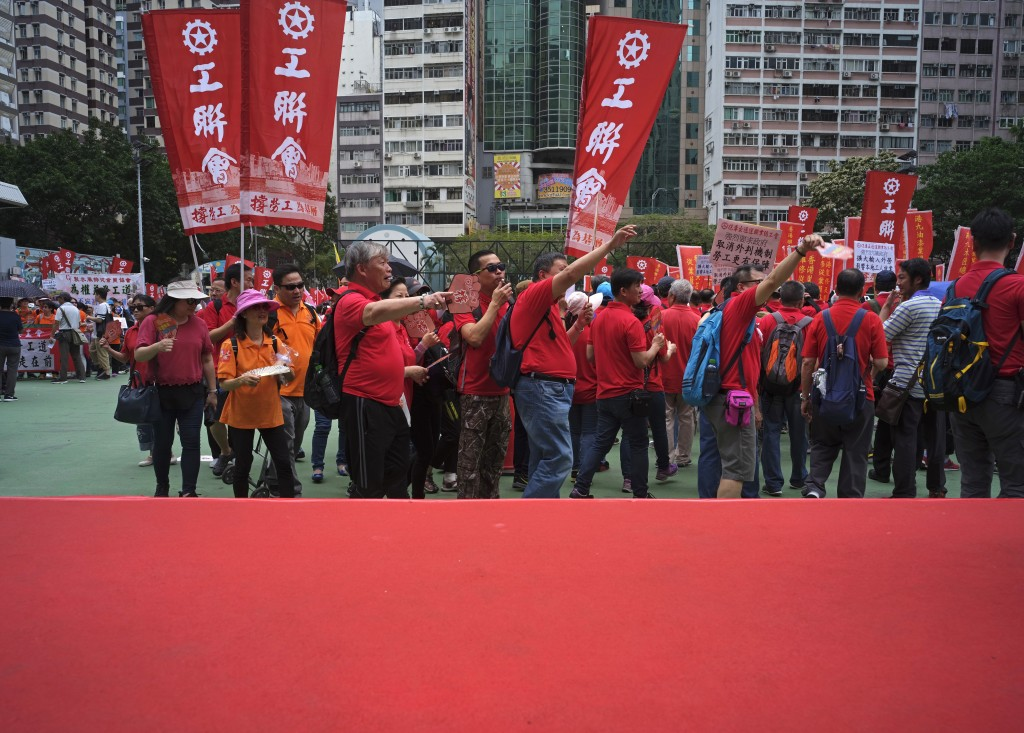 Protesters hold banners during a march to mark May Day in Hong Kong Tuesday, May 1, 2018. Hundreds of Hong Kong workers from various labor unions stag...