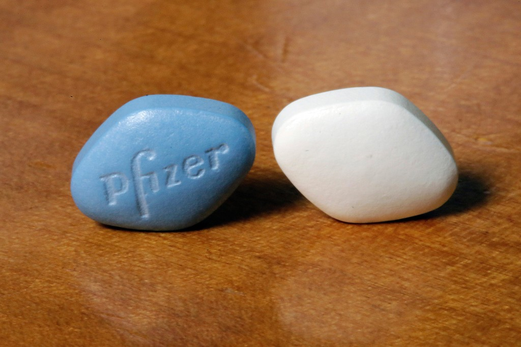 FILE- This Dec. 4, 2017, file photo shows a tablet of Pfizer's Viagra, left, and the company's generic version, sildenafil citrate, at Pfizer Inc., he...