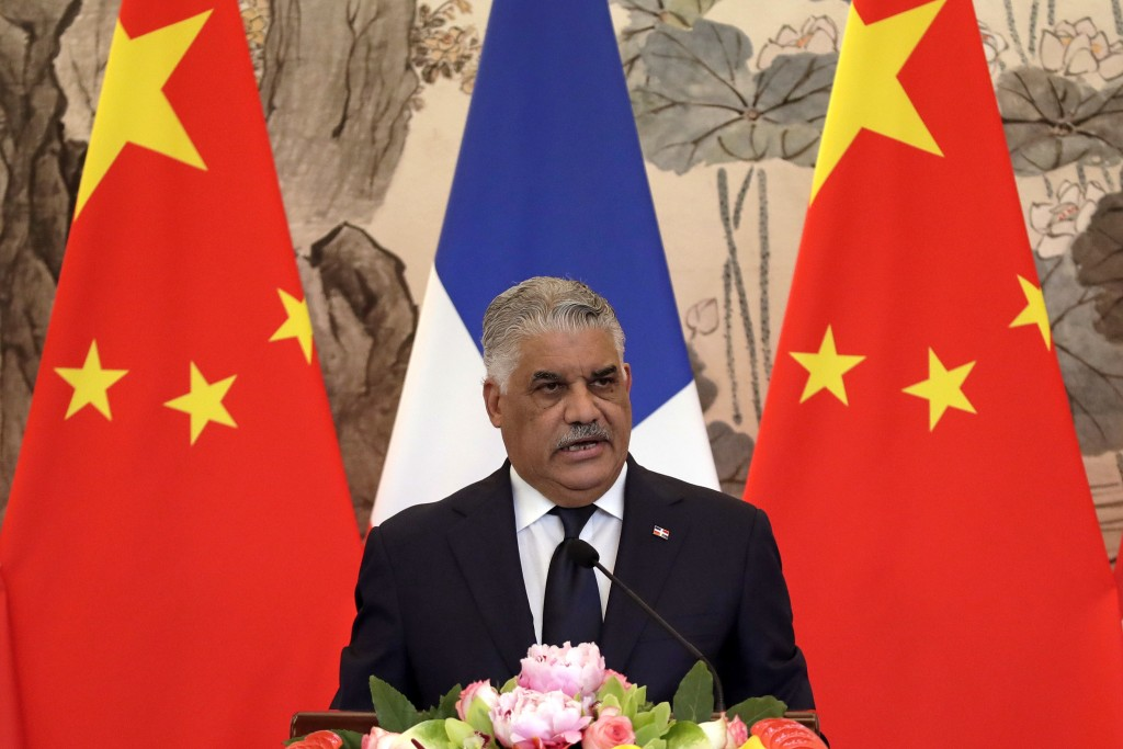 Dominican Foreign Minister Miguel Vargas speaks during a press briefing with Chinese Foreign Minister Wang Yi after they signed the joint communique a...