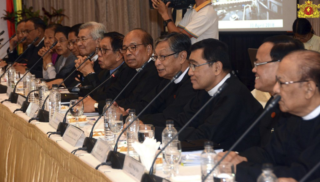 In this April 30, 2018, image provided by Myanmar's State Counsellor Office,  Myanmar's Government officials attend a meeting with ambassadors from th...