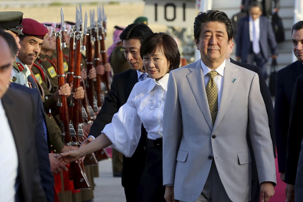 Japanese Prime Minister Shinzo Abe and his wife Akie Abe arrive at Amman military airport, in Amman, Jordan, Monday, April 30, 2018. (AP Photo/Raad Ad...