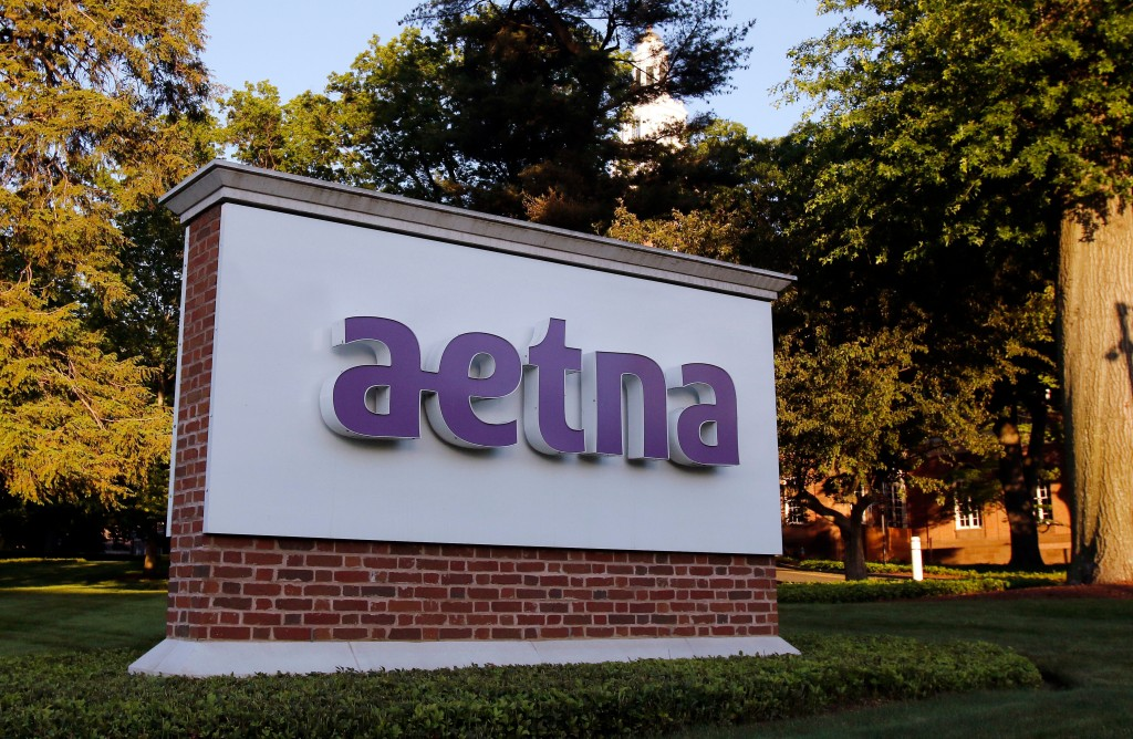 FILE - In this June 1, 2017, file photo, a sign stands on the campus of the Aetna headquarters, in Hartford, Conn. Aetna Inc. reports earnings Tuesday...