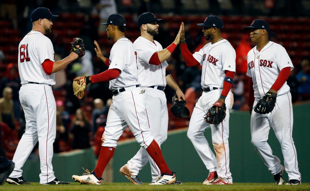 Boston Red Sox players, from left, Brian Johnson, Xander Bogaerts, Mitch Moreland, Eduardo Nunez and Rafael Devers celebrate after defeating the Kansa...