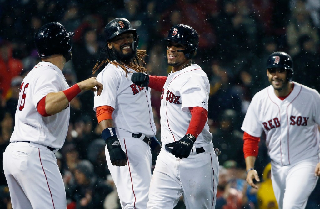 Boston Red Sox's Xander Bogaerts, center, celebrates his grand slam that also drove in, from left to right, Mitch Moreland, Hanley Ramirez and J.D. Ma...