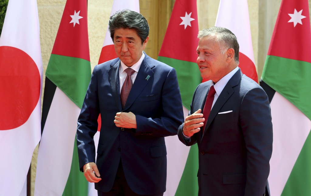 Japanese Prime Minister Shinzo Abe, left, is welcomed by King Abdullah II of Jordan at the Husseiniya palace in Amman, Jordan, Tuesday, May 1, 2018.  ...