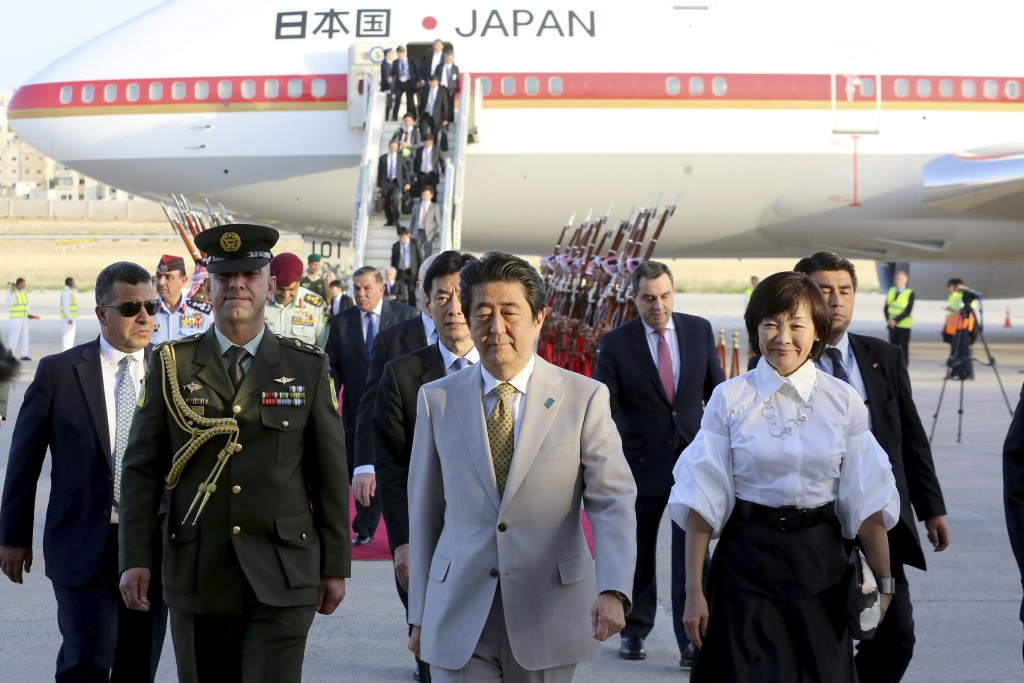Japanese Prime Minister Shinzo Abe and his wife Akie Abe upon his arrival at Amman military airport, in Amman, Jordan, Monday, April 30, 2018. (AP Pho...