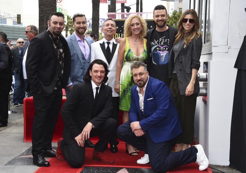 Chris Kirkpatrick, standing from left, Lance Bass, Paul Harless, Lynn Bomar Harless, Justin Timberlake, Jessica Biel, and kneeling from left, JC Chase...