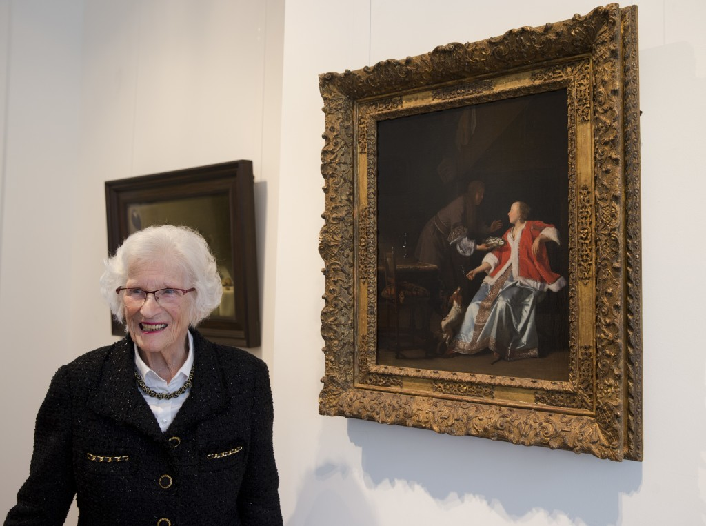 """Ninety-seven-year-old Charlotte Bischoff van Heemskerck poses next to the painting """"The Oyster Meal"""" by Jacob Ochtervelt (1634-1682) at Sotheby's in A..."""