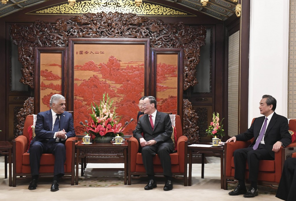 Dominican Republic's Foreign Minister Miguel Vargas, left, holds a meeting with Chinese Vice President Wang Qishan, center, and Chinese Foreign Minist...