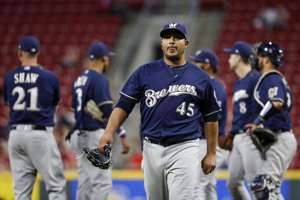 Milwaukee Brewers starting pitcher Jhoulys Chacin (45) reacts after being relieved in the fifth inning of a baseball game against the Cincinnati Reds,...
