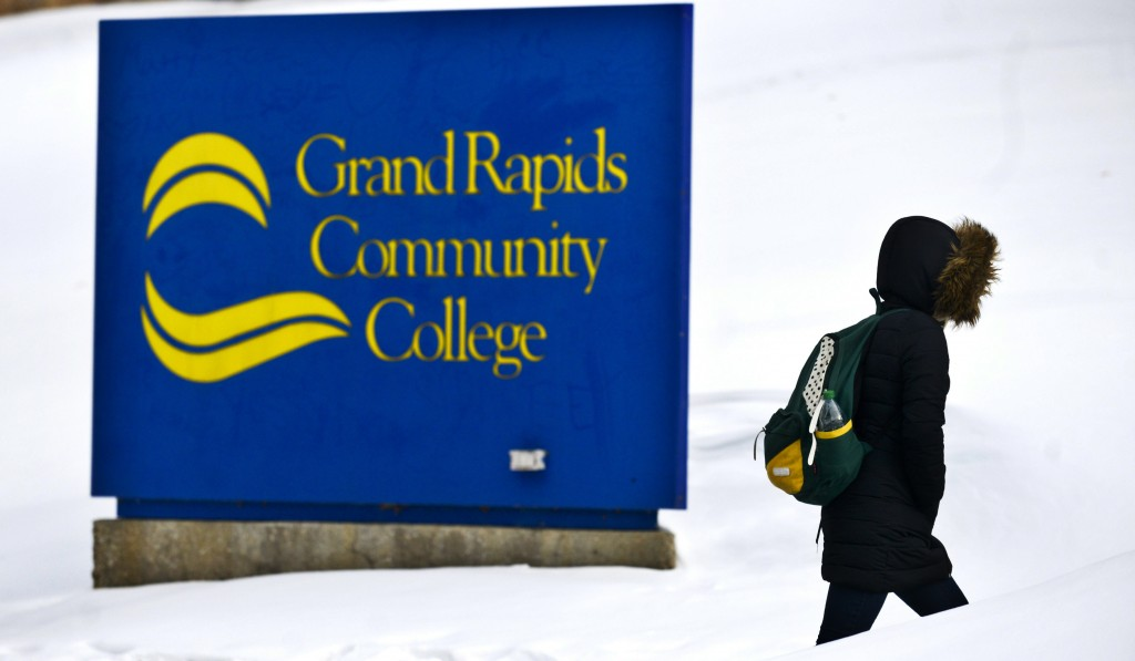 In this Feb. 20, 2015, file photo, a woman walks up Lyon Street near Grand Rapids Community College in Grand Rapids, Mich. College students who sudden...
