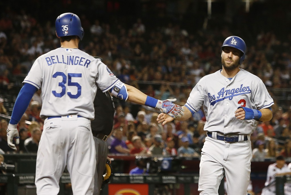 Los Angeles Dodgers' Chris Taylor (3) celebrates his run scored against the Arizona Diamondbacks with Cody Bellinger (35) during the sixth inning of a...
