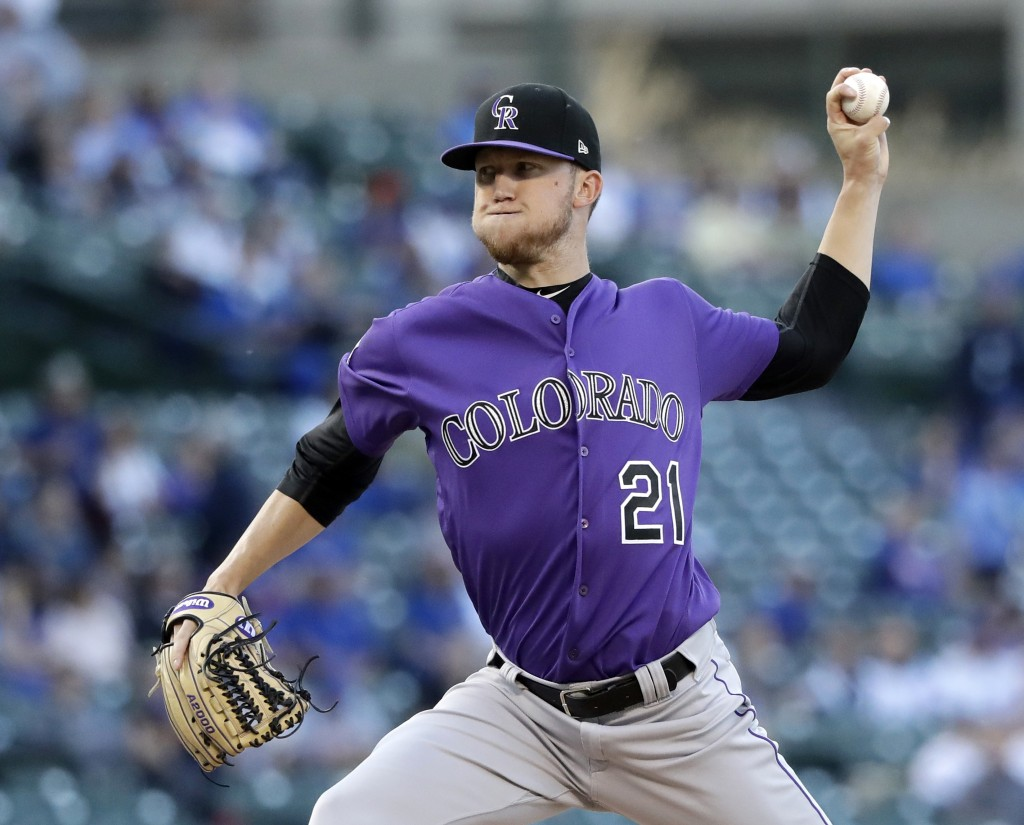 Colorado Rockies starting pitcher Kyle Freeland delivers during the first inning of a baseball game against the Chicago Cubs, Monday, April 30, 2018, ...