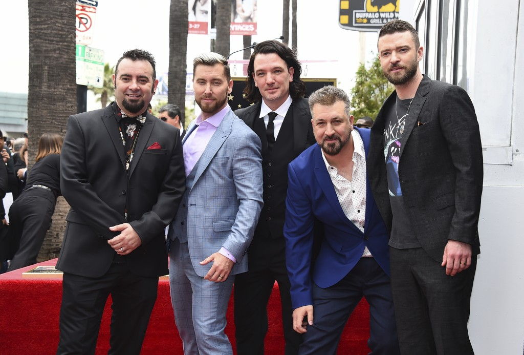 Chris Kirkpatrick, from left, Lance Bass, JC Chasez, Joey Fatone and Justin Timberlake attend a ceremony honoring NSYNC with a star on the Hollywood W...