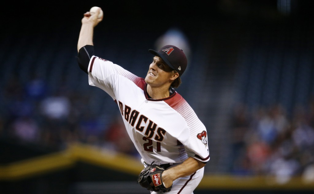 Arizona Diamondbacks starting pitcher Zack Greinke throws a pitch against the Los Angeles Dodgers during the first inning of a baseball game Monday, A...