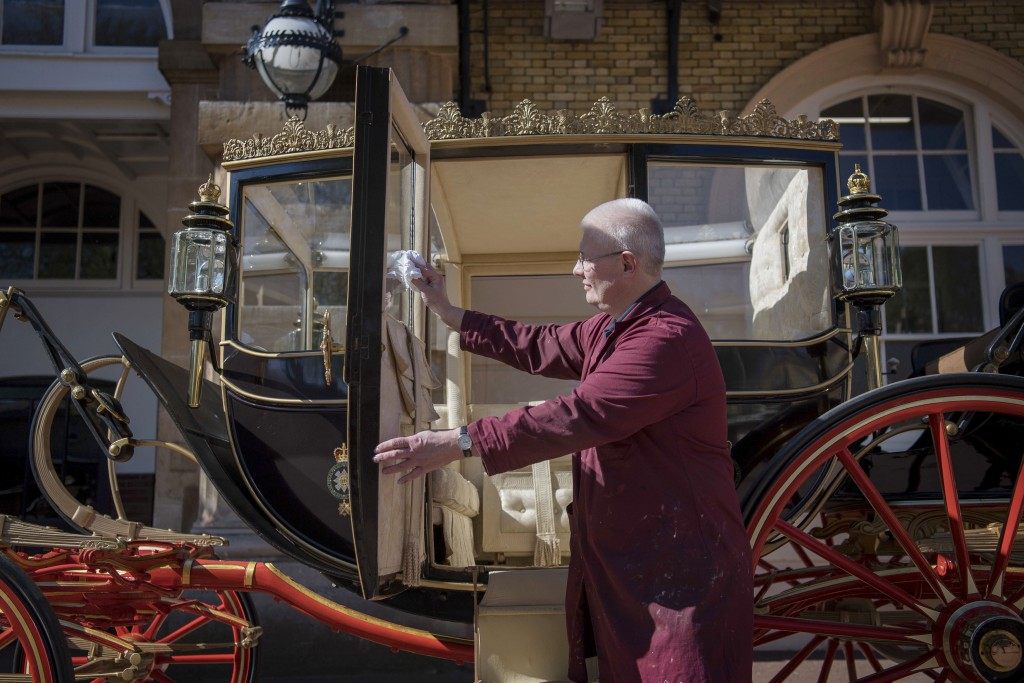 Martin Oates, Senior Carriage Restorer, polishes the Scottish State Coach, which will be used in the case of wet weather for the wedding of Britain's ...