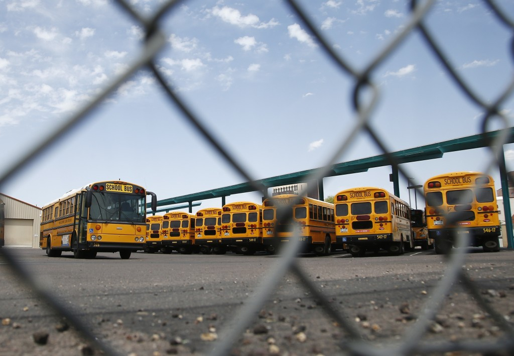 School buses sit idle at a main terminal as the statewide teachers strike enters a fourth day Tuesday, May 1, 2018, in Phoenix. (AP Photo/Ross D. Fran...