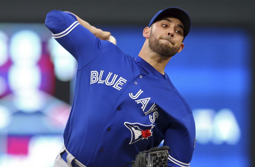 Toronto Blue Jays pitcher Marco Estrada throws to a Minnesota Twins batter during the first inning of a baseball game Tuesday, May 1, 2018, in Minneap...