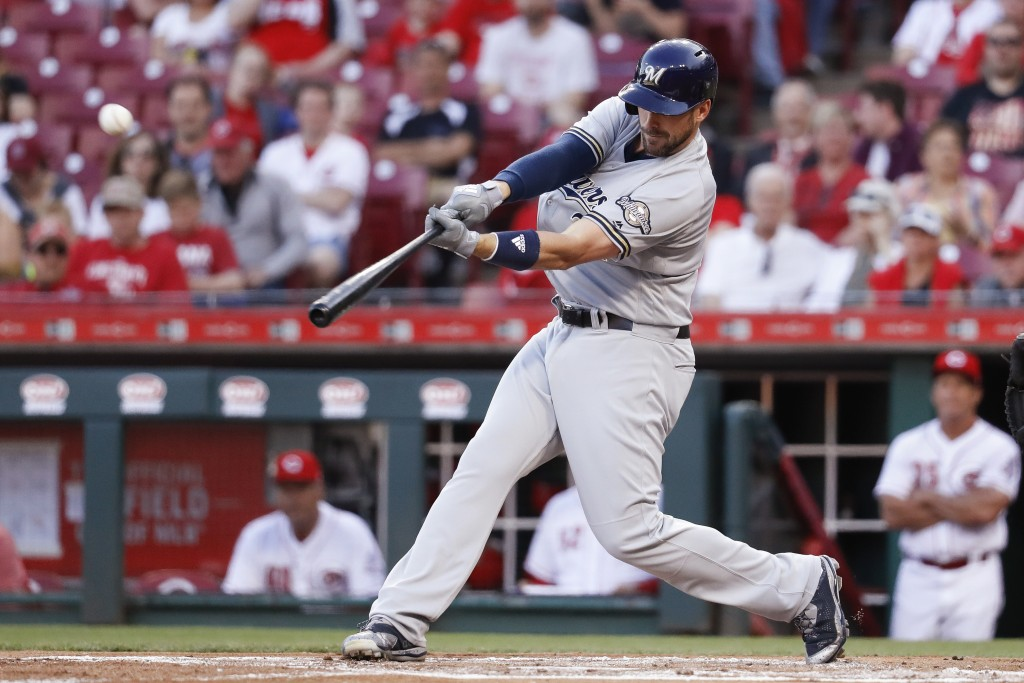 Milwaukee Brewers' Travis Shaw hits a two-run home run off Cincinnati Reds starting pitcher Homer Bailey duirng the first inning of a baseball game Tu...
