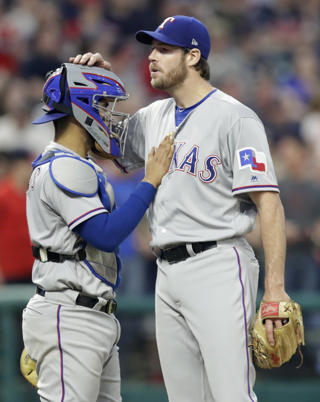 Texas Rangers catcher Robinson Chirinos pats starting pitcher Doug Fister on the chest just before Fister is removed from the game in the seventh inni...