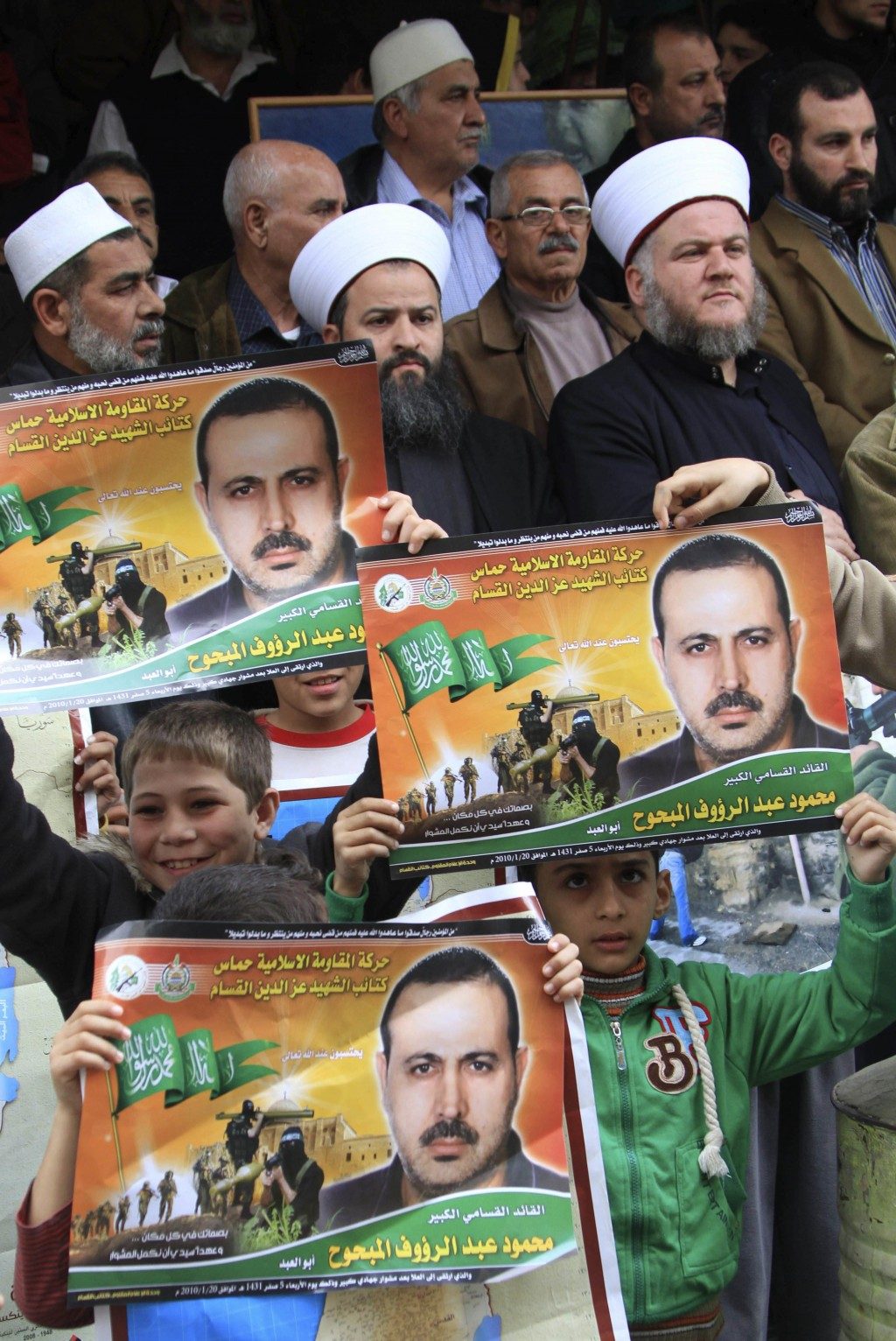 FILE - In this Friday, Feb. 26, 2010, file photo, Palestinians from Hamas and other groups carry pictures of slain Palestinian Mahmoud al-Mabhouh as t...