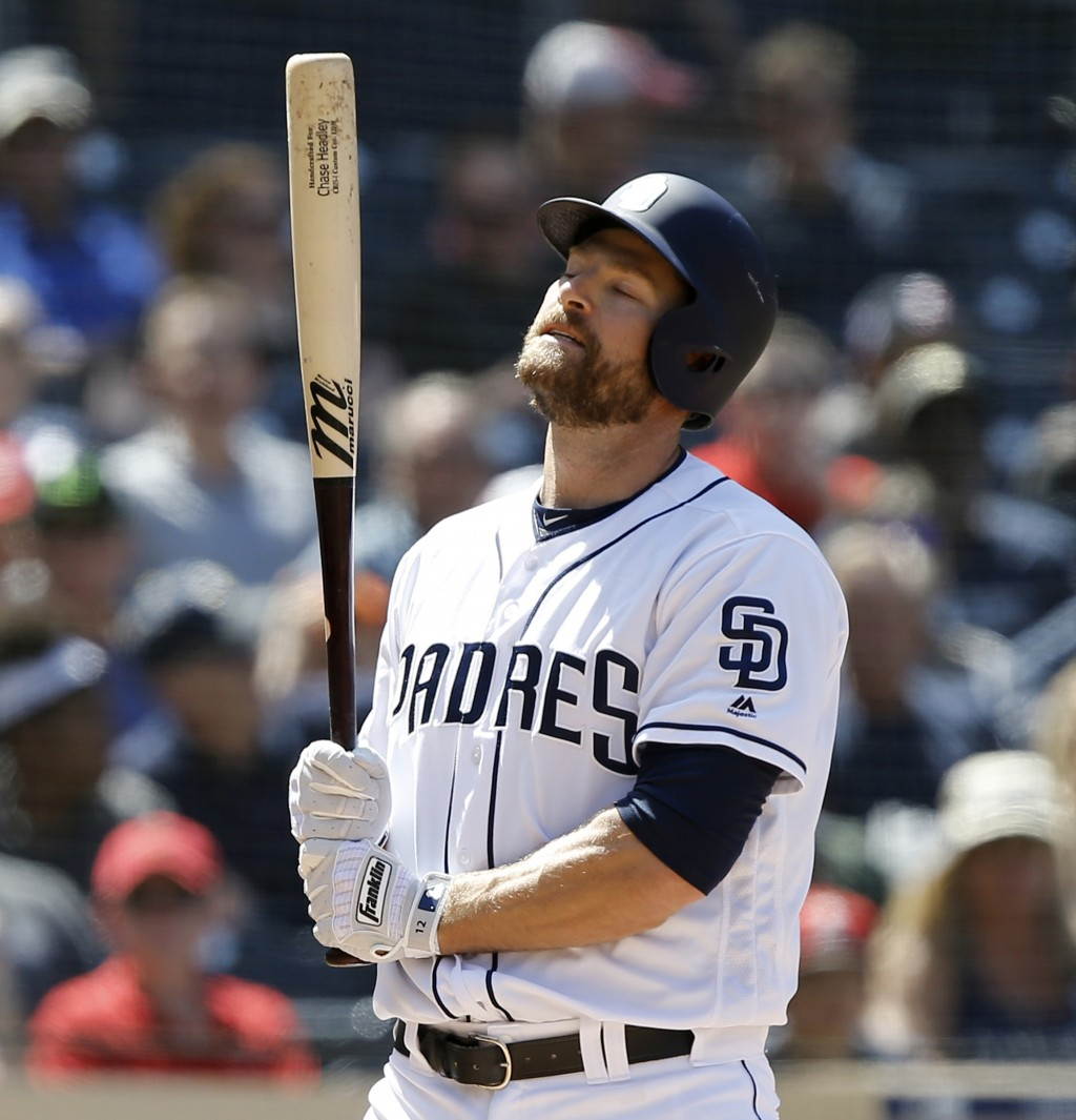 FILE - In this April 5, 2018, file photo, San Diego Padres' Chase Headley reacts after a called strike three during the fifth inning of a baseball gam...