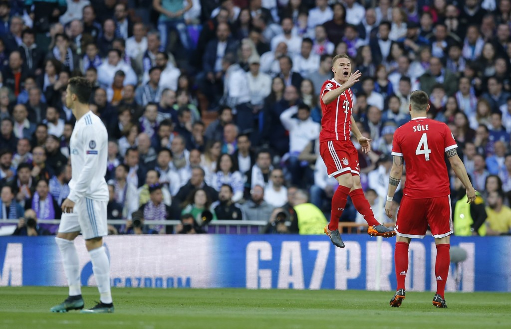 Bayern's Joshua Kimmich, center, celebrates after scoring the opening goal during the Champions League semifinal second leg soccer match between Real ...