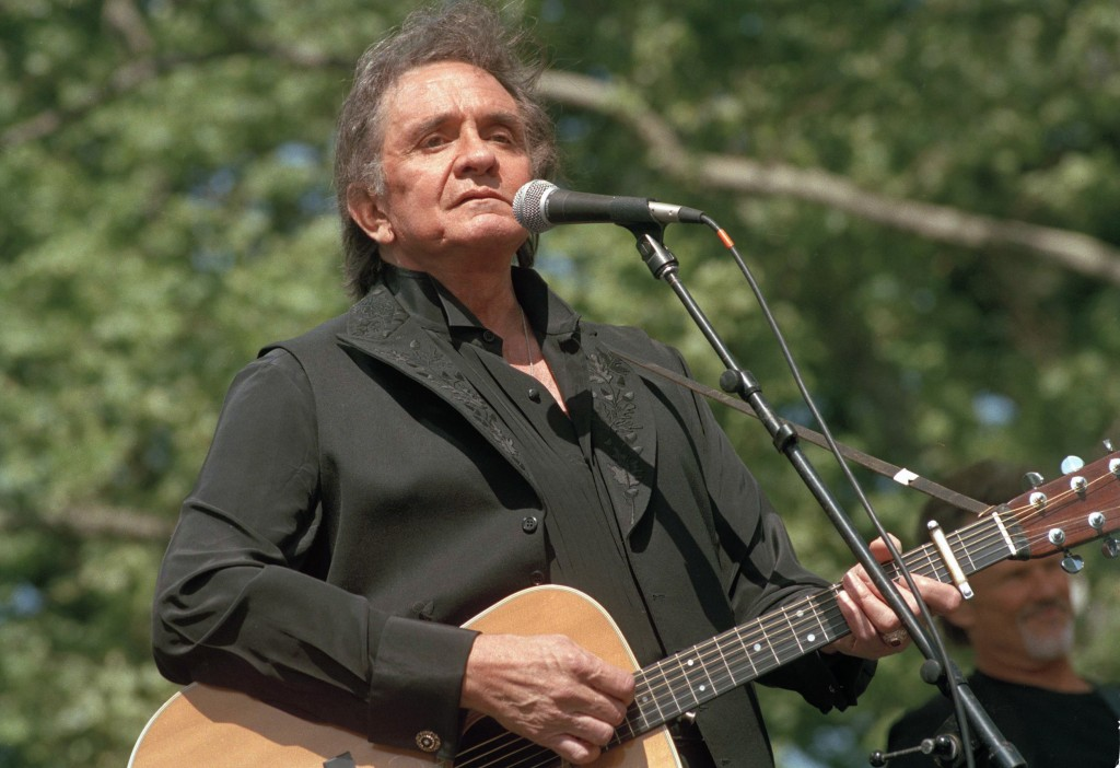 FILE - In this May 23, 1993 file photo, country legend Johnny Cash performs at a benefit concert at Central Park in New York. Cash's first gold record...