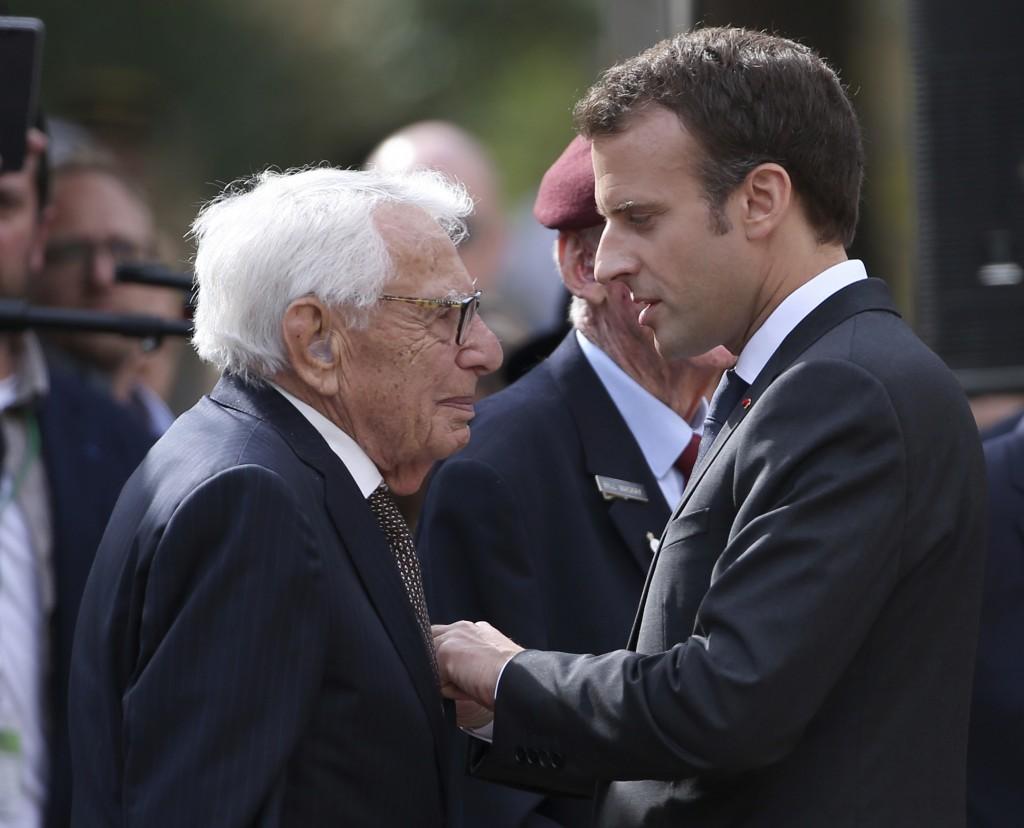 French President Emmanuel Macron, right, presents the Legion d'Honneur award to Australian war veteran Louis Solomons in Sydney, Wednesday, May 2, 201...