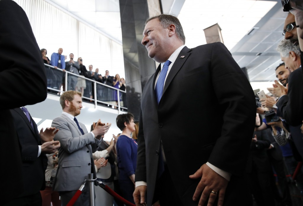 New Secretary of State Mike Pompeo greets State Department employees as he arrives at the State Department in Washington, Tuesday, May 1, 2018. (AP Ph...