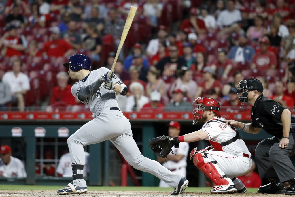 Milwaukee Brewers' Ryan Braun hits a two-run double off Cincinnati Reds starting pitcher Homer Bailey during the fifth inning of a baseball game Tuesd...