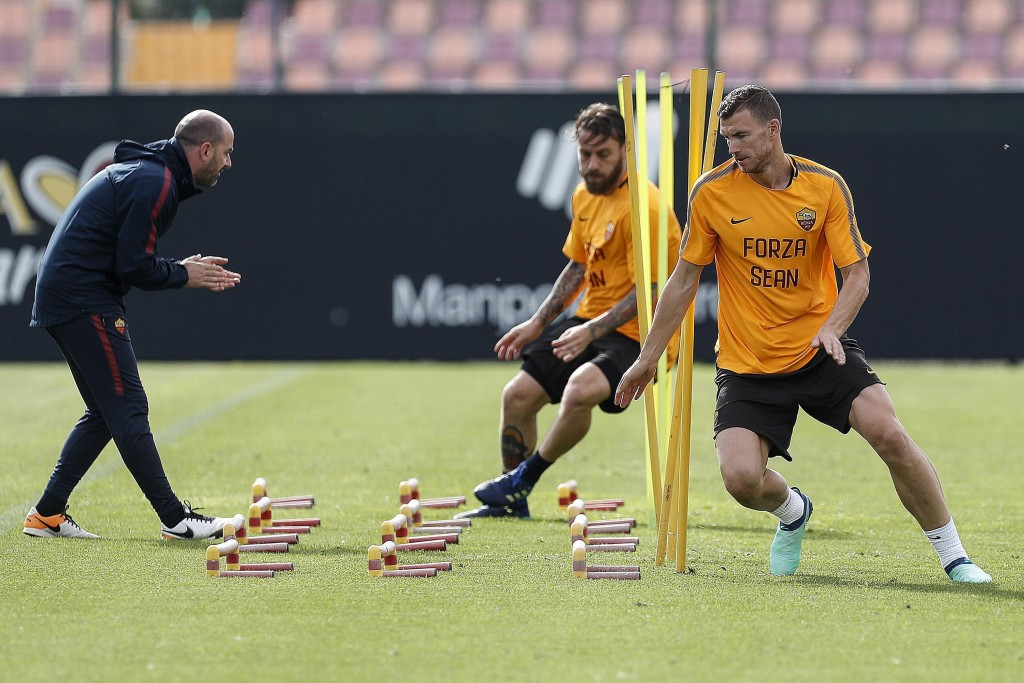 """AS Roma's Edin Dzeko, right, and Daniele De Rossi, center, wear shirts with writing reading """"Go Sean"""", dedicated to Liverpool fan Sean Cox, who remain..."""