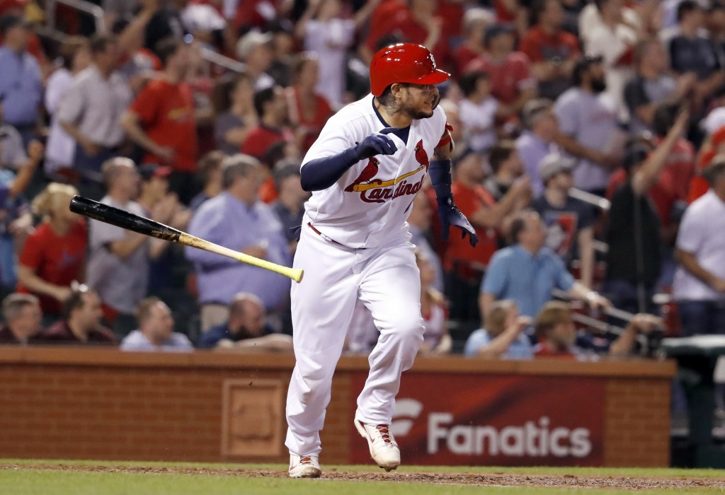 St. Louis Cardinals' Yadier Molina tosses his bat after hitting a walk-off single during the ninth inning of a baseball game against the Chicago White...