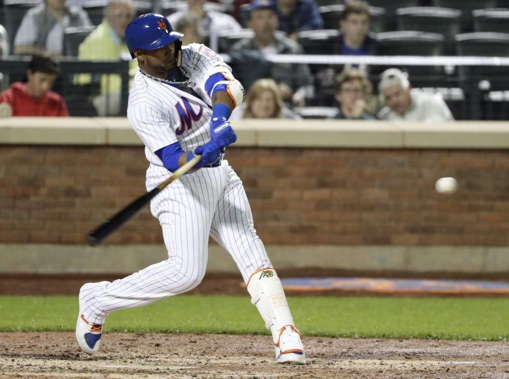 New York Mets' Yoenis Cespedes hits a home run during the sixth inning of a baseball game against the Atlanta Braves Tuesday, May 1, 2018, in New York...