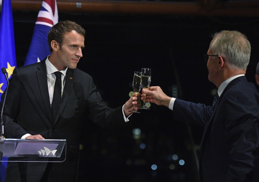 President of France, Emmanuel Macron, left, and Australian Prime Minister, Malcolm Turnbull, toast during a dinner at the Sydney Opera House in Sydney...