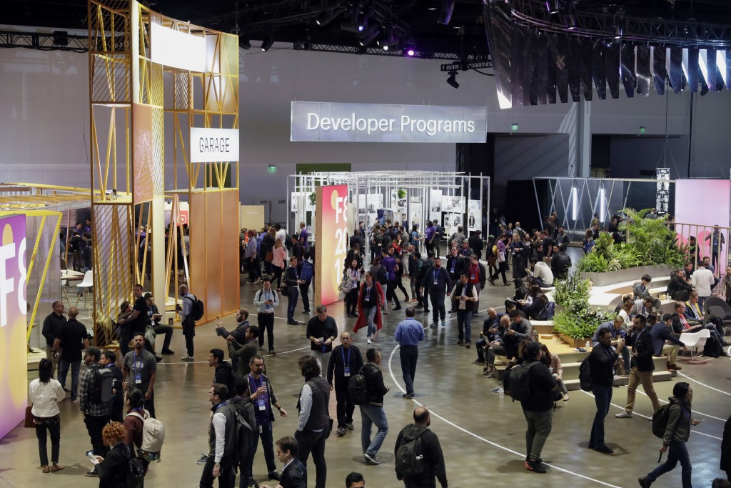 Attendees roam the showroom floor during F8, Facebook's developer conference, Tuesday, May 1, 2018, in San Jose, Calif. (AP Photo/Marcio Jose Sanchez)