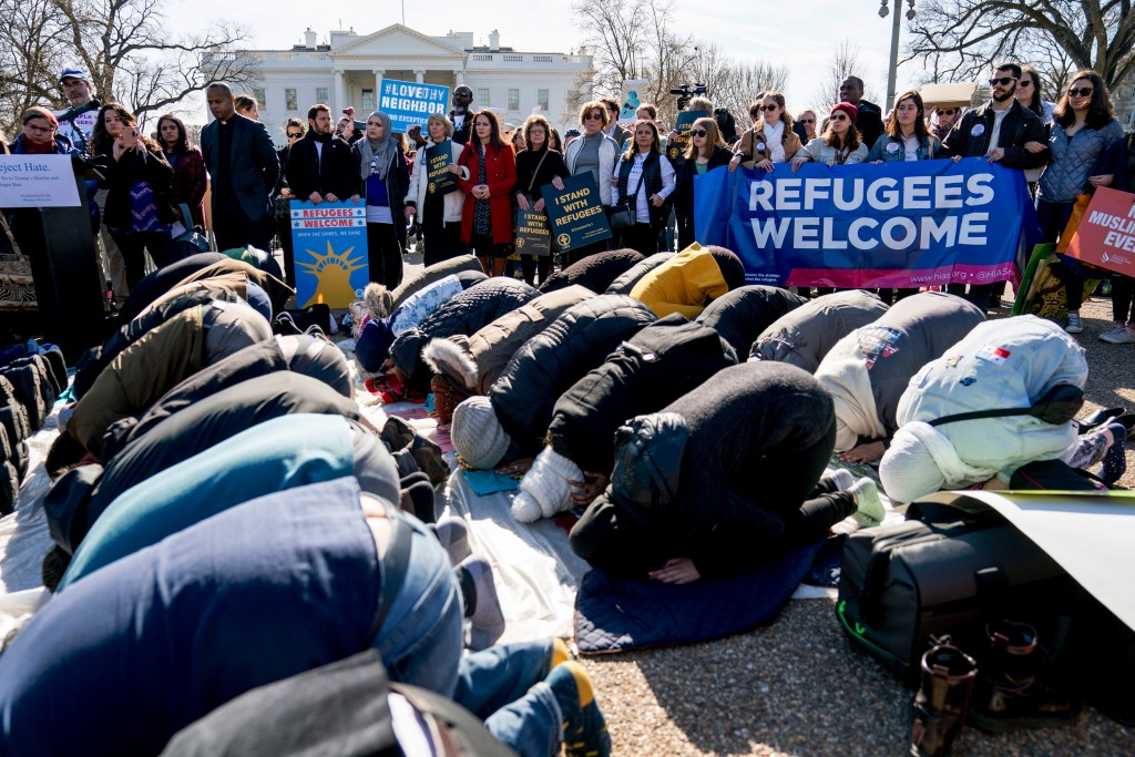 FILE - In this Jan. 27, 2018 file photo, supporters surround a group who perform the Islamic midday prayer outside the White House in Washington durin...