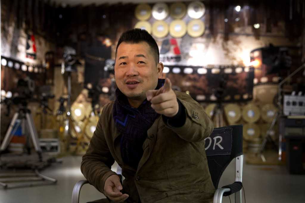 """In this Thursday, March 22, 2018 photo, Wei Tie, the director of the state-backed documentary film """"Amazing China"""" speaks during an interview at the B..."""
