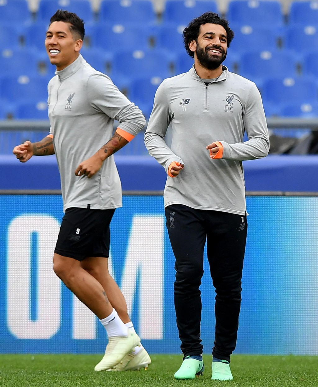 Liverpool players Mohamed Salah, right, and Roberto Firmino attend a team training session at the Olympic Stadium, in Rome, May 1, 2018. Liverpool wil...