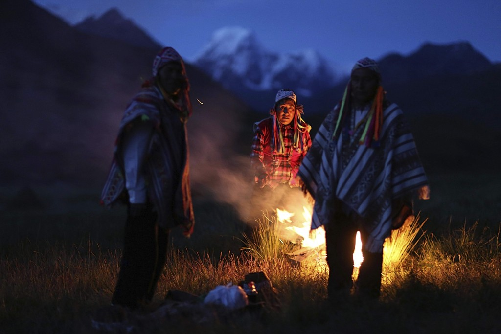In this April 4, 2018 photo, Andean farmers take part in a ceremony honoring Mother Earth and Father Snowy Mountain, in Pitumarca, Peru. The surge in ...